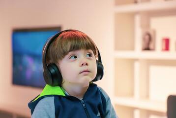 A photo of a child wearing headphones